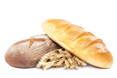 Bread and wheat ears on white background. Bread and wheat ears isolated on white background. Wheat and rye Royalty Free Stock Images