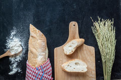Bread , wheat and flour on black chalkboard  bakery background Stock Image