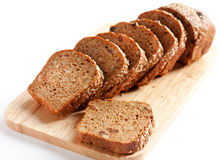 Bread from wheat flour, whole grain bread. Cut into pieces Royalty Free Stock Images