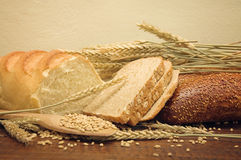 Bread and wheat grains Royalty Free Stock Photos