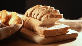 Bread and wheat. Homemade cooking made from whole wheat and grains with breads stock footage