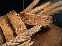 Bread and Wheat. Isolated on black background royalty free stock image