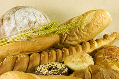 Bread with wheat leaves. Different kids of wheat breads Royalty Free Stock Photography