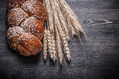 Bread wheat and rye ears on wooden board Royalty Free Stock Photography