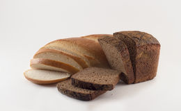 Bread. Wheat and rye bread sliced on a white background Stock Photo