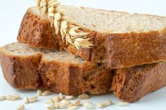 Bread and wheat spike. On white background royalty free stock photography