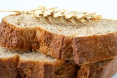 Bread and wheat spike. On white background stock photos