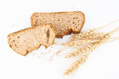 Bread and wheat spike. On white background royalty free stock images