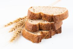 Bread and wheat spike. On white background royalty free stock image
