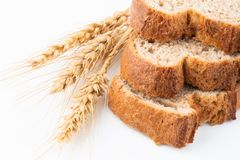Bread and wheat spike. On white background royalty free stock photos