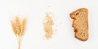 Bread and wheat spike. On white background stock images