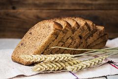 Bread wheat spike on wooden background. The bread wheat spike on wooden background Royalty Free Stock Photo