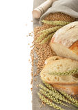 Bread and wheat. On the white background stock photos