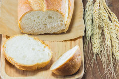 The bread and wheat on the wood background, selective focus Stock Images