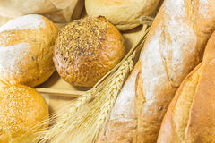 The bread and wheat on the wood background, warm toning, selective f Royalty Free Stock Images