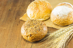 The bread and wheat on the wood background, warm toning, selective f Stock Photo