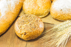 The bread and wheat on the wood background, warm toning, selective f Royalty Free Stock Photo