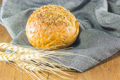 The bread and wheat on the wood background, warm toning, selective f Royalty Free Stock Photos