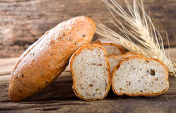 Bread and wheat. On the wooden royalty free stock images