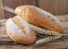 Bread and wheat. On the wooden stock image