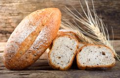 Bread and wheat. On the wooden stock photos