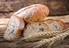 Bread and wheat. On the wooden stock photography