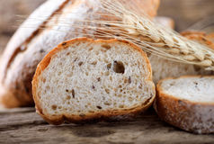 Bread and wheat. On the wooden royalty free stock photography