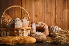 Bread and wheat on the wooden Royalty Free Stock Images