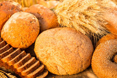 Bread and wheat on the wooden table Royalty Free Stock Images