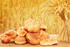 Bread and wheat on the wooden table Royalty Free Stock Photo