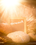 Bread and wheat on the wooden table Royalty Free Stock Photos