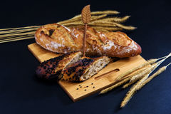 bread and wheat on wooden Royalty Free Stock Photography