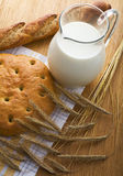 Bread, wheaten ears and a milk jug Royalty Free Stock Photo
