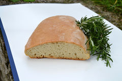 Bread whit rosemary. On white table Stock Images