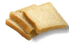 Bread on a white background. Three pieces of toast, close-up Stock Photo