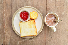 Bread on white dish with Cocoa. Bread on white dish with hot cocoa Royalty Free Stock Photography