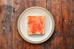 Bread on white dish. Bread with jam on white dish Stock Images