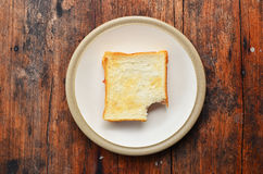 Bread on white dish. Bread with jam on white dish Royalty Free Stock Photos