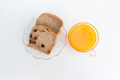 Bread on a white plate and glass of orange juice. Isolated on white. Royalty Free Stock Photo