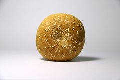 Bread with white sesame seeds on white background. it is a food made of flour, water, and yeast royalty free stock photos