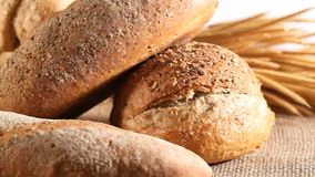 Bread and  whole wheat. Homemade cooking made from whole wheat and grains with breads stock video footage