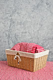 Bread in wicker basket covered with kicthen rag Royalty Free Stock Photo
