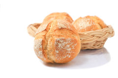 Bread in wicker basket isolated on white Royalty Free Stock Image