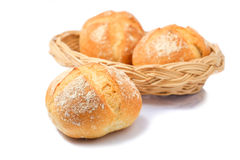 Bread in wicker basket isolated on white Royalty Free Stock Photo