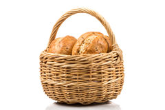 Bread in wicker basket isolated on white Stock Photo