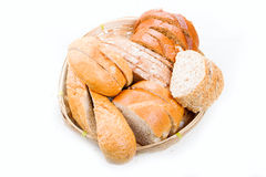 Bread in a wicker breadbasket on white background Stock Images