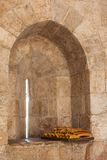 Bread on the windowsill in old tower, Jerusalem Royalty Free Stock Image