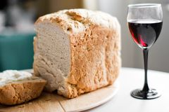 Bread and wine. Wine and bread over wooden planks closeup Royalty Free Stock Photo