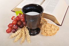 Bread and wine. Bread, wine and bible for sacrament or communion Stock Photography