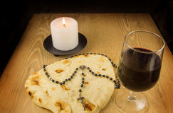 Bread, Wine, Candle and Rosary Stock Photo